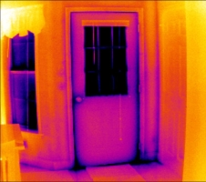Poor weatherstripping around door found by thermal camera energy audit